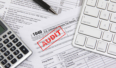 tax documents with an audit stamp
